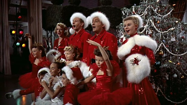 The cast of 'White Christmas' in front of a Christmas tree.