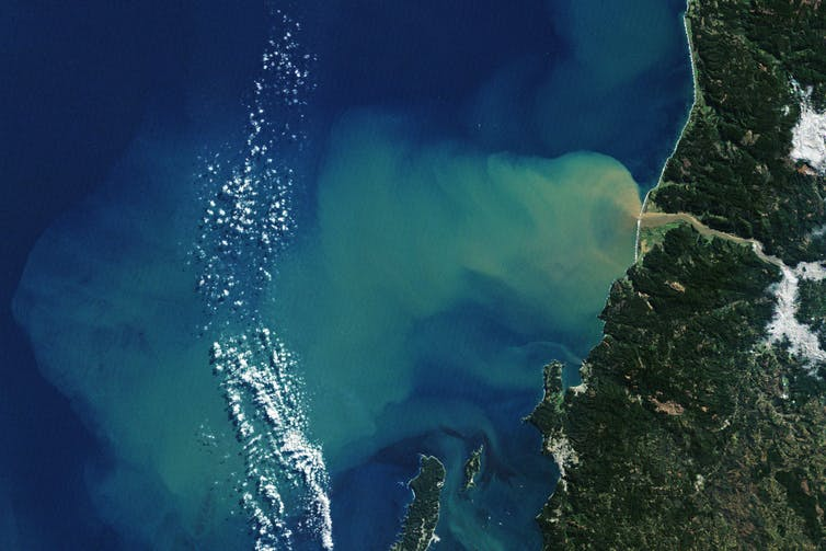 After an atmospheric river event that caused severe flooding in Chile, sediment washed down from hillsides into the Itata River can be seen flowing up to 50 kilometers from the coast. NASA Earth Observatory