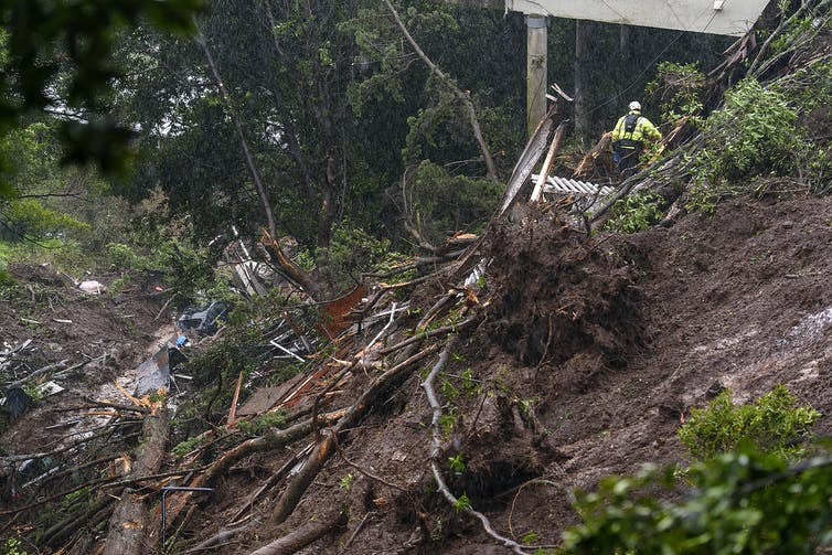 Rescue workers sift through debris after a mudslide that destroyed three homes on a hillside in Sausalito, Calif., Feb. 14, 2019, during an atmospheric river storm. AP Photo/Michael Short