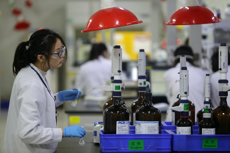Employees work at the center for early phase pharmaceutical development of Asymchem Laboratories Inc