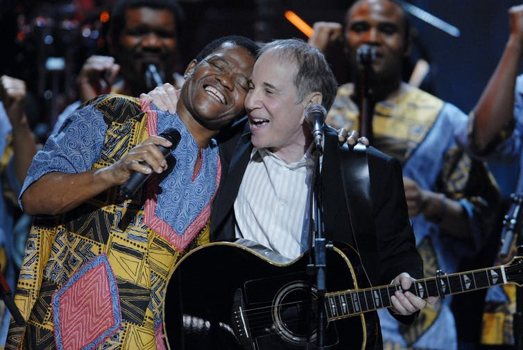 Joseph Shabalala beams during a Washington performance with Paul Simon in 2007. Scott Suchman/WireImage