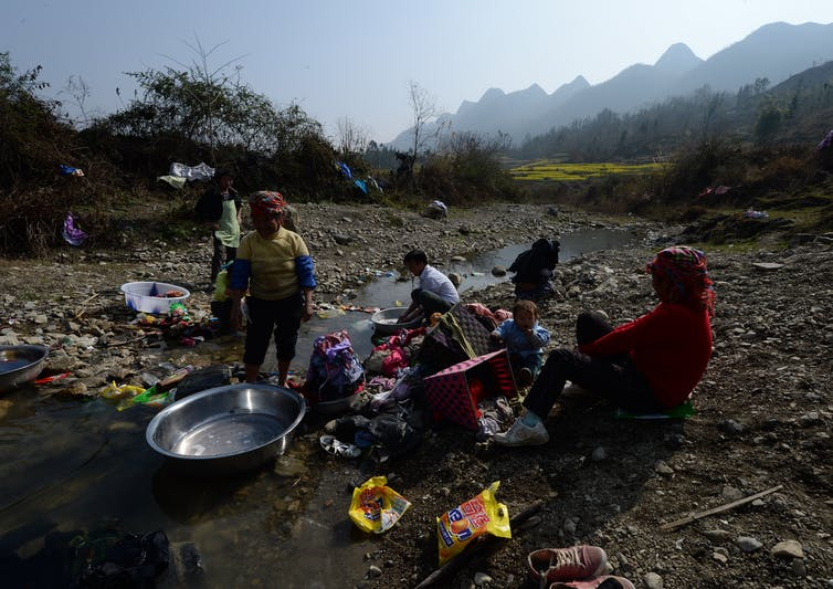 Residents do their washing in Guizhou Province, China, Feb. 20, 2014. While China's cities explode, rural poverty remains entrenched. MARK RALSTON/AFP via Getty Images