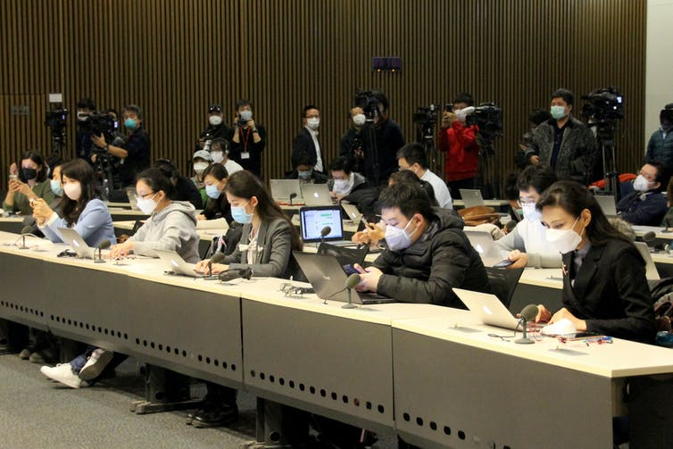 Journalists at the first regular in-person press briefing by the Chinese Foreign Ministry since briefings had gone online during the coronavirus outbreak, Feb. 24, 2020. Roman Balandin\TASS via Getty Images