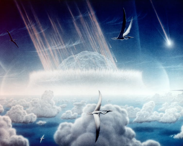 An artist's impression of a huge asteroid hurling towards Earth in prehistoric times, past pterosaurs that are flying in the clouds.