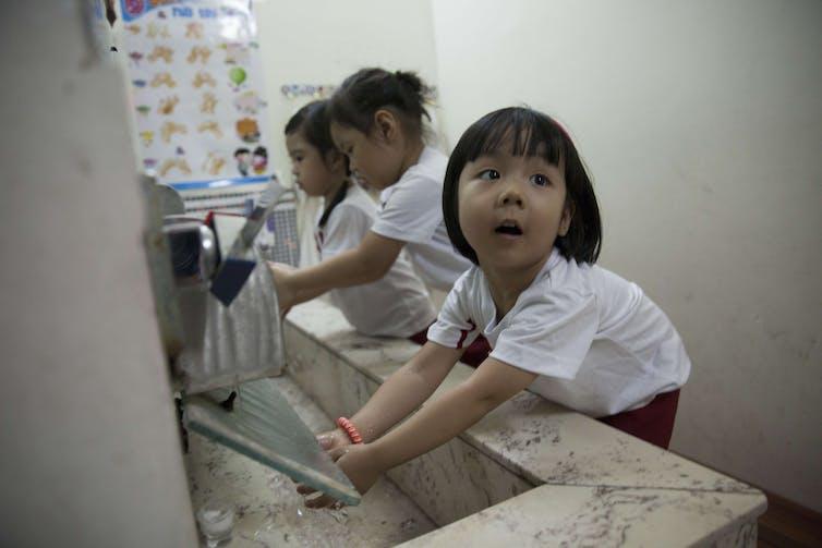 Students washing hands at sakura montessori