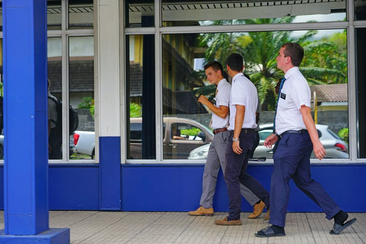 Young Mormon missionary men walking in Papeete, Tahiti.EQRoy/Shutterstock.com