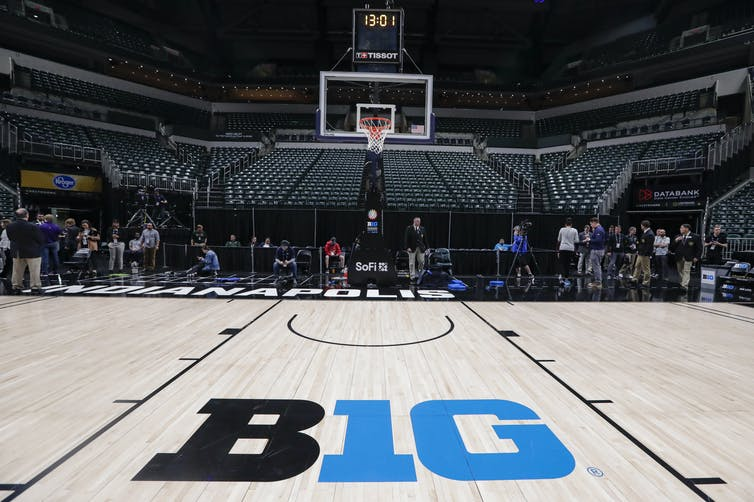 Empty stadiums, canceled conferences and deserted city streets are a sign social distancing is happening. AP Photo/Michael Conroy