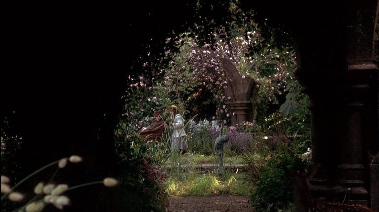 Movie still from 1993, children play in the garden