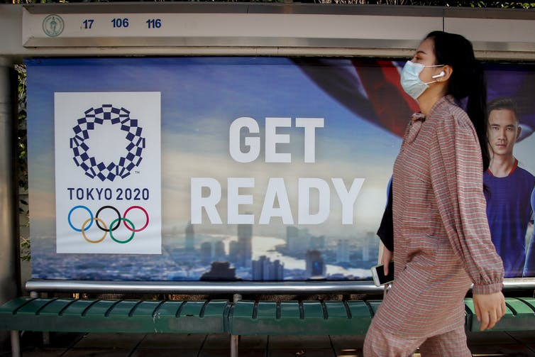 Why haven't the Olympics been cancelled from coronavirus? That's the A$20bn question
