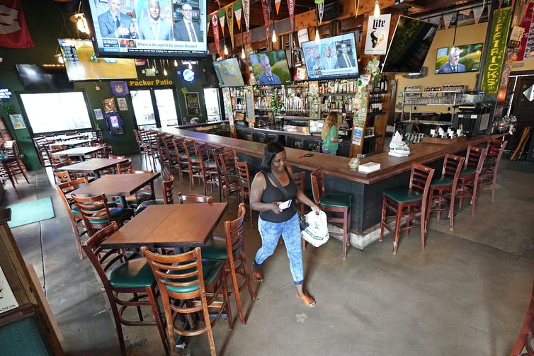 A customer picks up takeout food from a restaurant in Houston, Texas. AP Photo/David J. Phillip