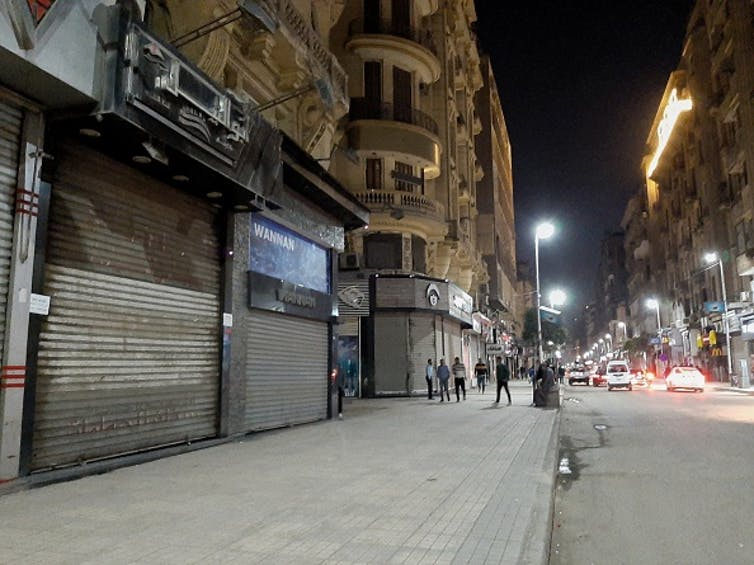 A deserted street in Cairo after the government ordered the closure of shops, restaurants and cafes. Photo by Ziad Ahmed/NurPhoto via Getty Images