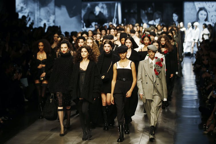 Milan's Fashion Week drew models, designers and other fashion professionals from around the world, even in late February 2020.AP Photo/Antonio Calanni