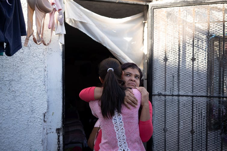 A Salvadoran migrant hugs a friend she fears she may never see again, at El Buen Pastor Methodist Church, Ciudad Juárez, Mexico, June 12, 2019. Paul Ratje/AFP via Getty Images