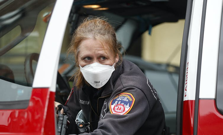 Health care workers, first responders and others on the front lines are at risk for depression from COVID-19. Here, a first responder in New York City is pictured March 25, 2020, outside a testing site at Elmhurst Hospital Center. AP Photo/John Minchillo