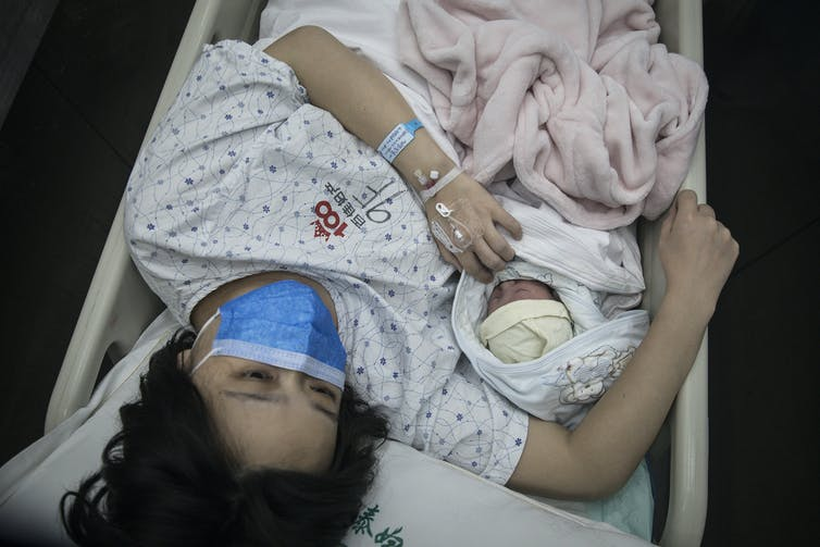 As the coronavirus pandemic spread through Wuhan, China in early 2020, pregnant women faced new risks as hospitals began to run short of supplies. In the U.S., some hospitals started limiting visitors during delivery to reduce the chance of spreading the disease. Getty Images