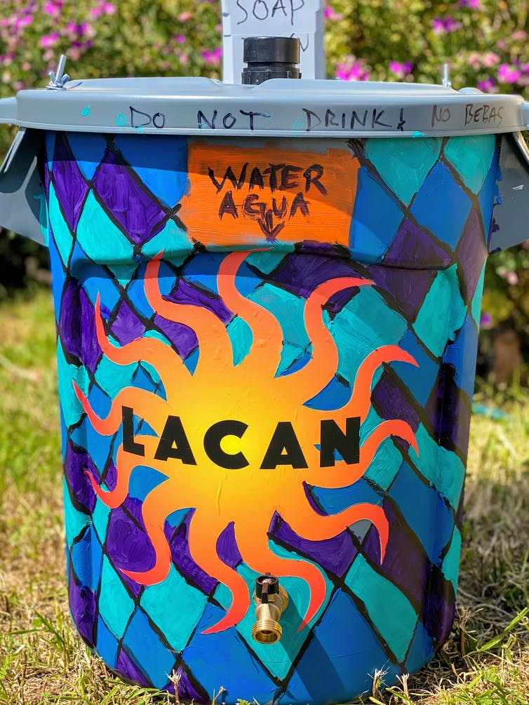 An artist-assisted DIY hand-washing station for the homeless. Marie Quinn, CC BY-ND