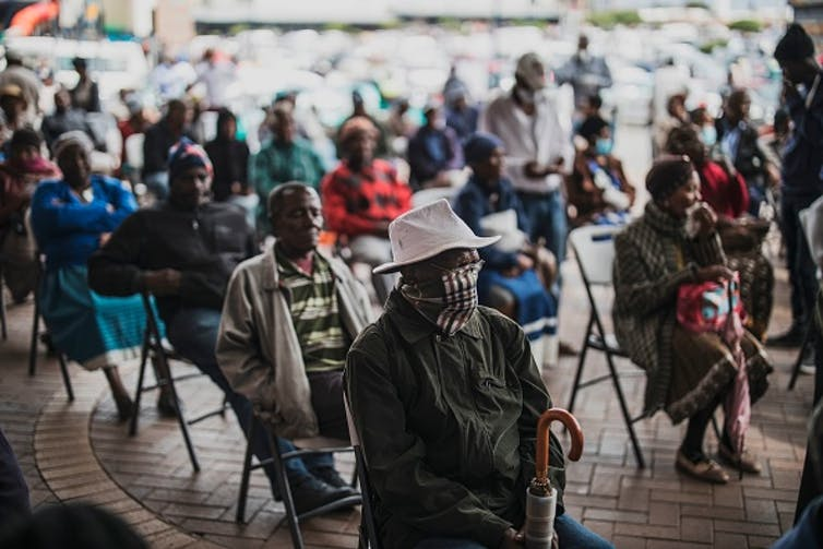 An elderly man at a social grant paypoint in South Africa after the COVID-19 lockdown. (Photo by MARCO LONGARI / AFP) () Photo by Marco Longari/AFP via Getty Images