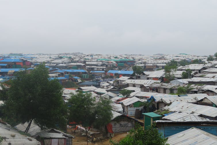 homes in the camp with cloudy gray sky overhead, photo