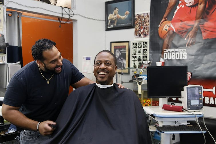 A barbershop near Los Angeles teamed up with pharmacists to monitor customers' blood pressure. AP Photo/Damian Dovarganes