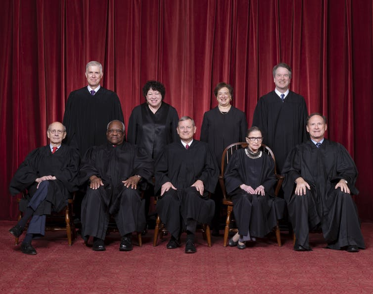 The Roberts court, from 2018. Seated, from left: Justices Stephen G. Breyer and Clarence Thomas, Chief Justice John G. Roberts Jr., and Justices Ruth Bader Ginsburg and Samuel A. Alito. Standing, from left: Justices Neil M. Gorsuch, Sonia Sotomayor, Elena Kagan and Brett M. Kavanaugh. Fred Schilling, Supreme Court of the United States/Wikimedia Commons