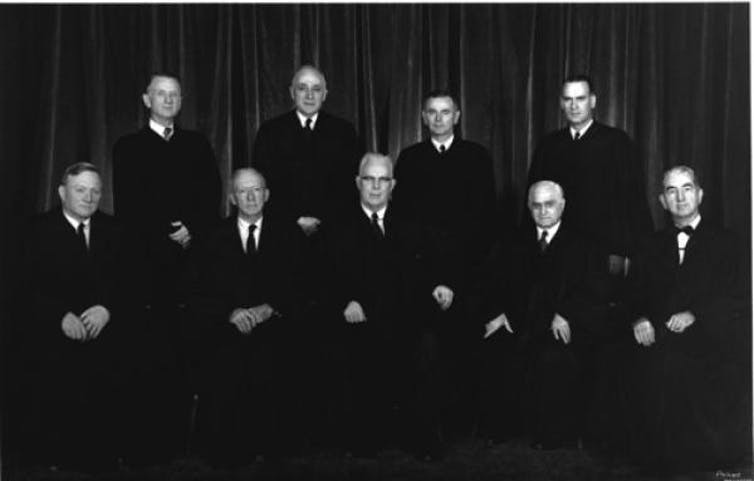 The Warren court from 1958 to 1962. Standing, from left: Justices Charles E. Whittaker, John M. Harlan, William J. Brennan, Jr., Potter Stewart. Seated, from left, Justices William O. Douglas and Hugo L. Black, Chief Justice Earl Warren, and Justices Felix Frankfurter and Tom C. Clark. Supreme Court of the United States/Wikimedia Commons