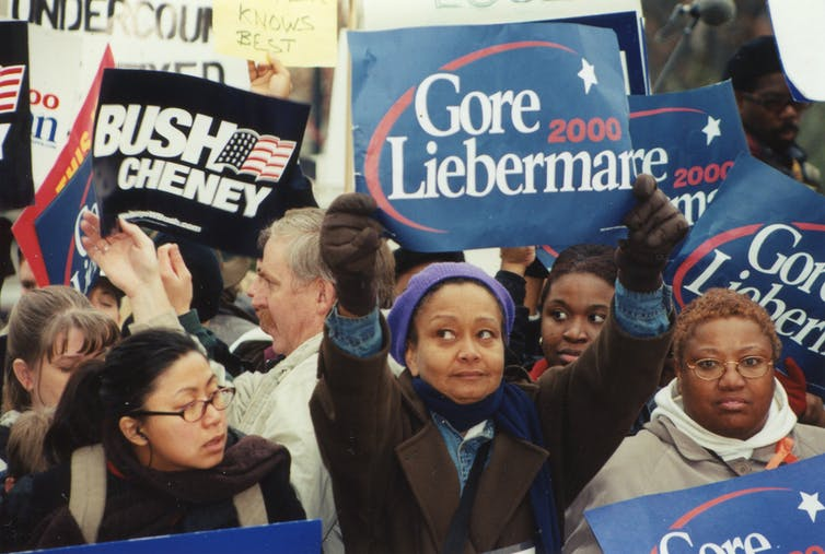 Supporters of George W. Bush and Al Gore protest outside the Supreme Court building in December 2000. Elvert Barnes, CC BY-SA