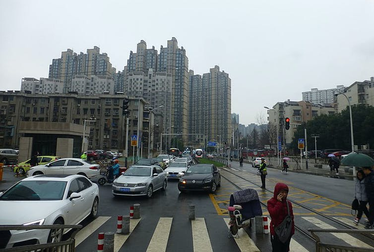 Global cities such as Wuhan (pictured in March 2018) require investments in lower-carbon urban development to enhance public health. Wikipedia, CC BY