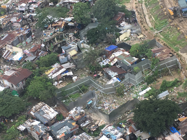 'Forced' evictions eat away at a Manila community as developer spares the golf course next door