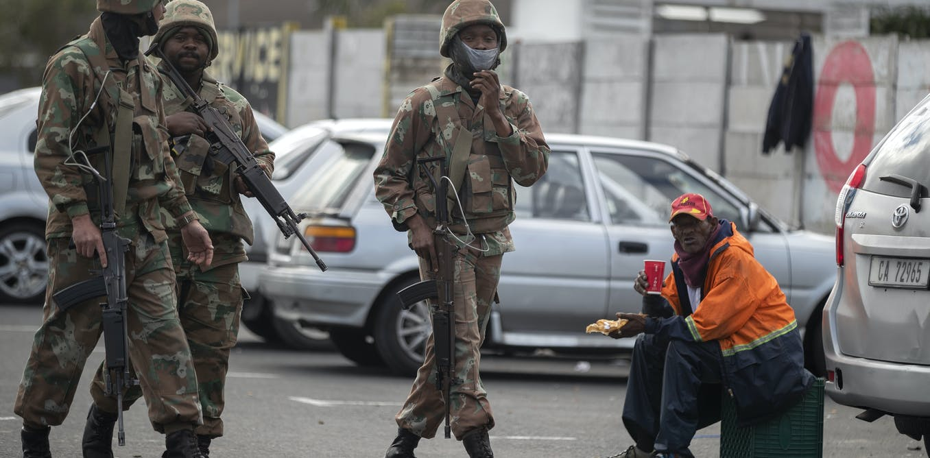 South African soldiers enforcing the COVID-19 lockdown in Mitchells Plain, Cape Town EPA/Nic Bothma