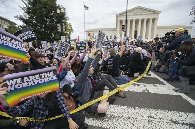 Supporters of LGBT rights protest in front of the U.S. Supreme Court. AP Photo/Manuel Balce Ceneta
