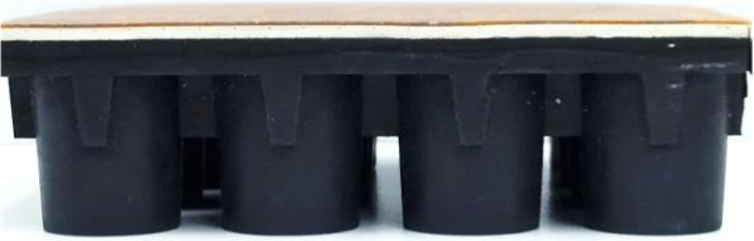 Cross-section of flooring showing rubber cylinders on the underside.