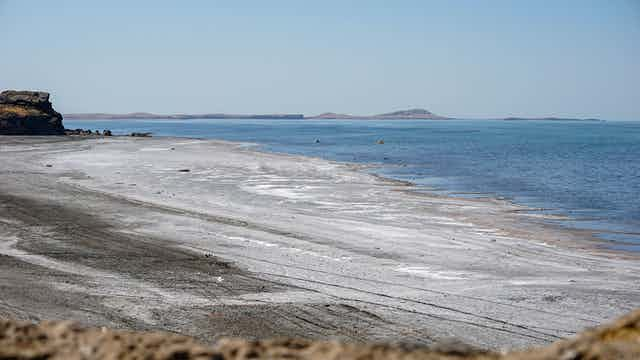 Beach lake with salty shoreline.