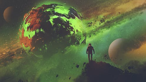 A man gazes at a distant fictional green planet.