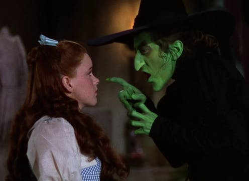 Dorothy looks up at the Wicked Witch of the West.