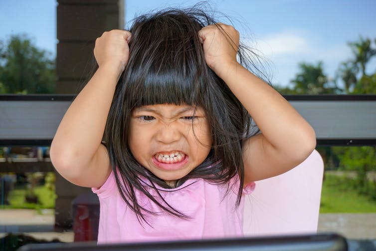 Stressed child with attention deficit hyperactivity disorder (ADHD)