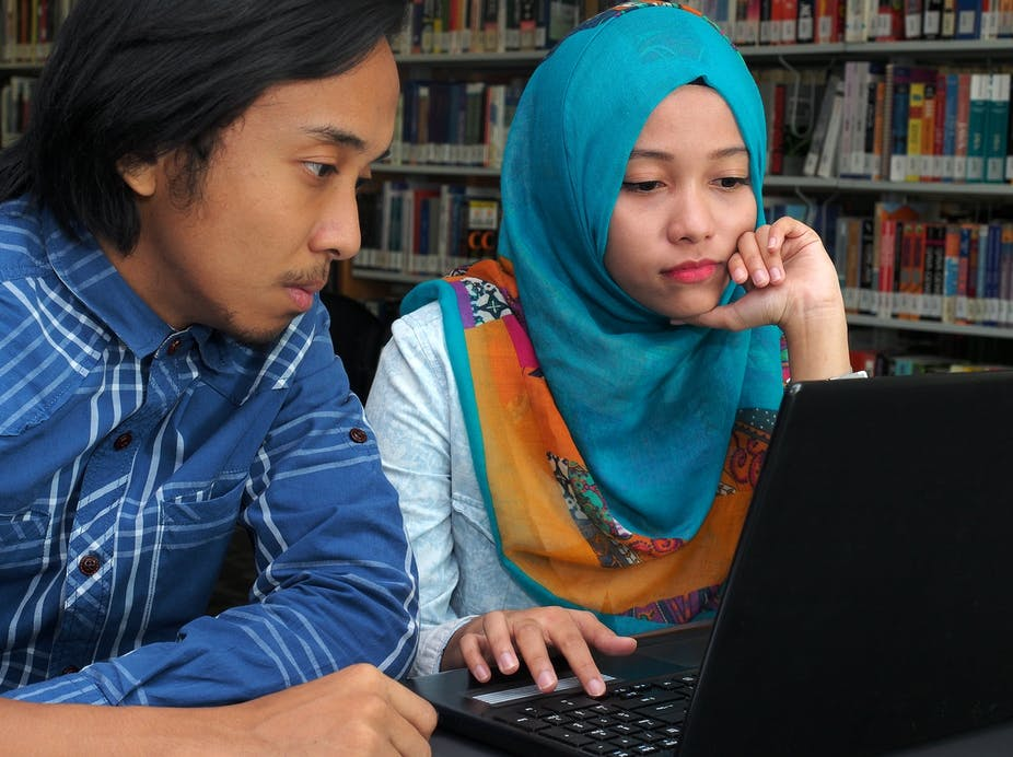 Two students in a library.