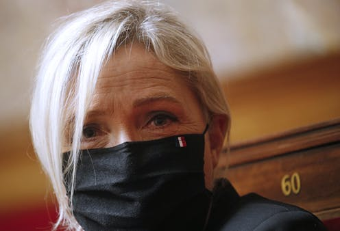 Marine Le Pen wears a mask in parliament.