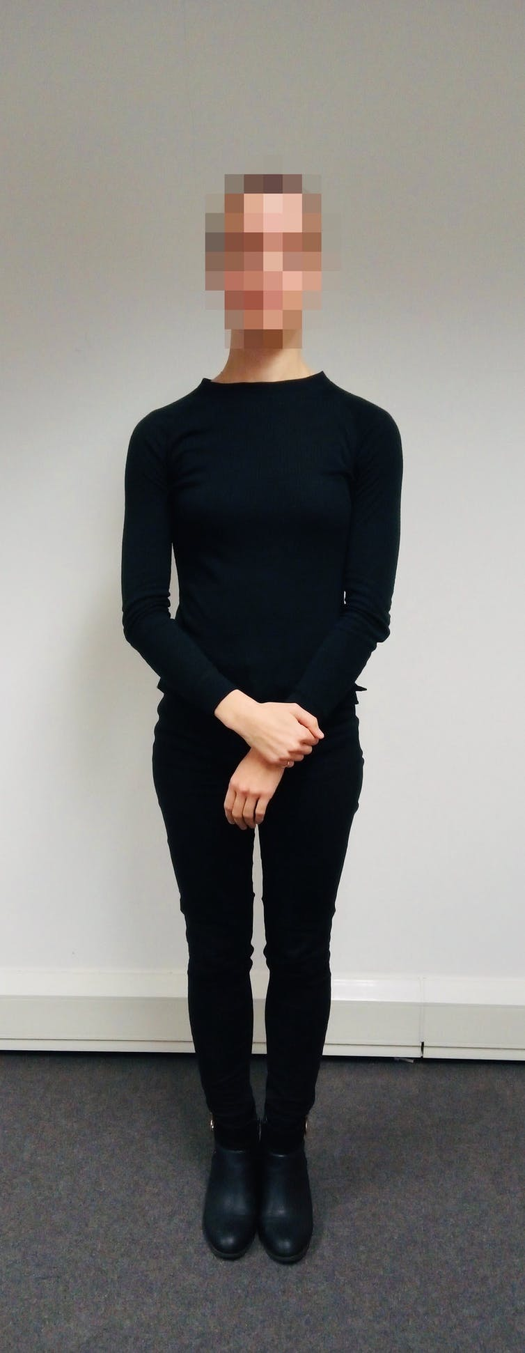 Person standing in a neutral pose