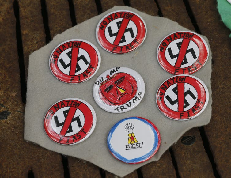 A vendor displays anti-racism buttons in Charlottesville, Va., in August 2018.
