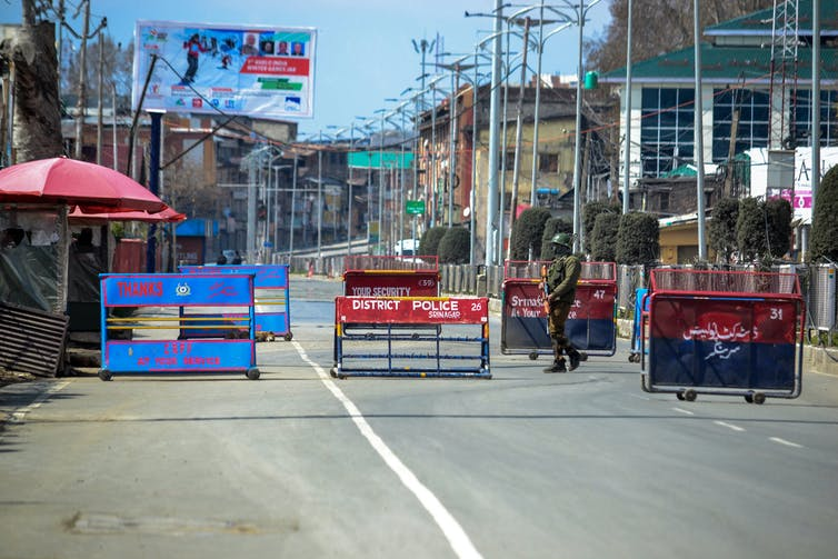 Barricades and a soldier on a Kashmir street