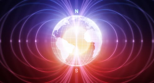 Abstract picture of Earth with magnetic field showing.