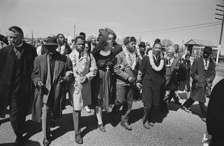 Religious leaders march with the Rev. Martin Luther King Jr.