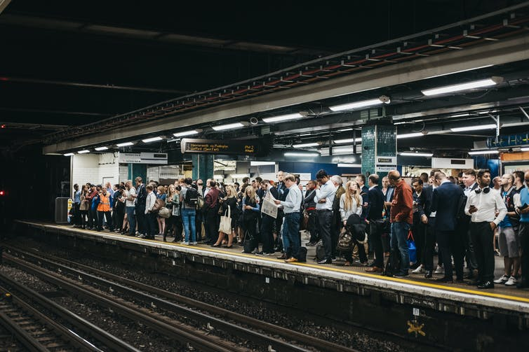 Busy train platform during London commute.