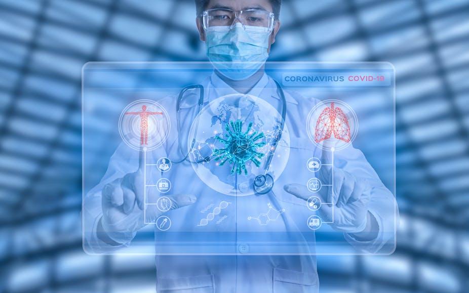 Doctor looks at Coronavirus on computer