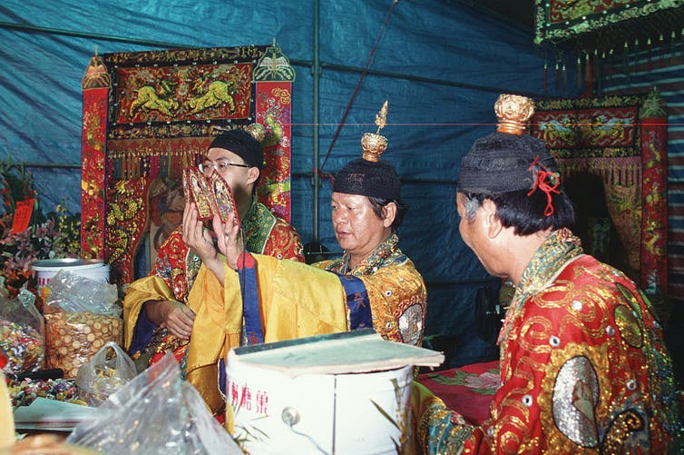 Three Priests performing ritual, photo