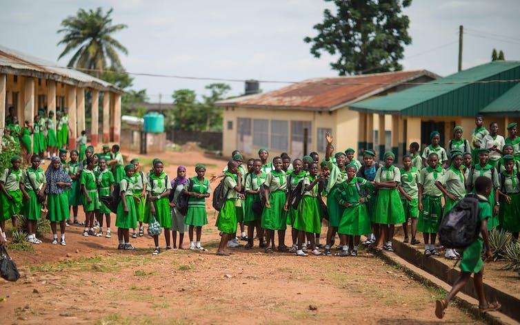 Girls on road outside school