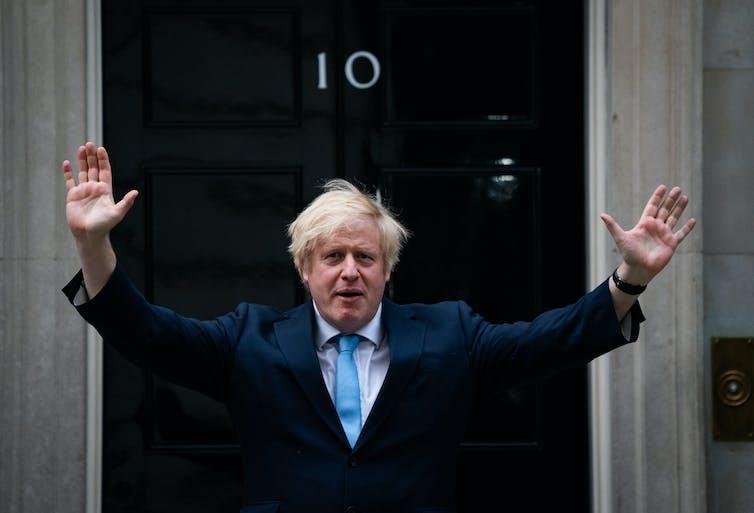 Boris Johnson waves outside Downing Street