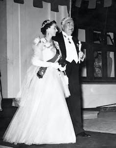 The Queen walks with Robert Menzies.