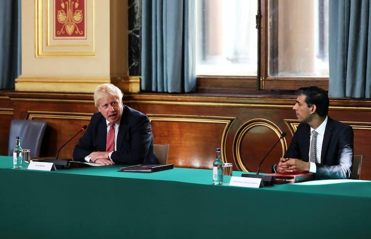 Boris Johnson and Rishi Sunak discussing cabinet business.
