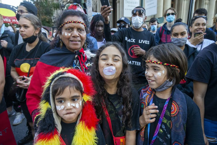 Mother and young children at Australian Black Lives Matter protest.